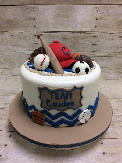 Baby shower cake boy. Sports themed baby shower cake for a boy with baseball, soccer, basketball even a baseball bat and hat.