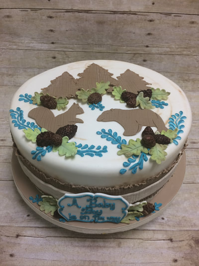 Baby sower cake with woodland animals.