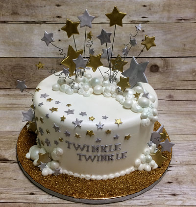 twinkle twinkle baby shower cake. gold and silver stars and gold dust around cake for that bling look.
