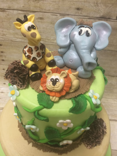 Jungle theme baby shower cake with fondant jungle animals.