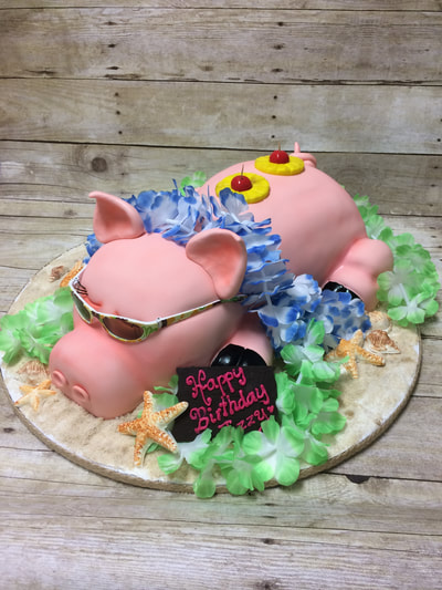 Happy birthday cake of a cute pig laying down wearing sunglasses surrounded by tropical flowers. Click here for larger image.