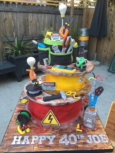 Birthday cake for an electrician, 3 tier with tools made out of fondant that an electrician would use. Click here to see larger image.