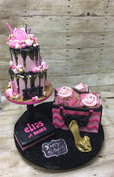 Purse cake with high heel shoe cupcakes and two tier drip cake.