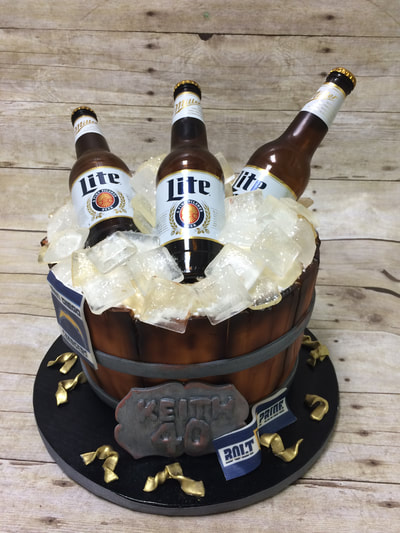Beer birthday cake in the shape of a cut in half barrel filled with ice and beer bottles. happy birthday cake.