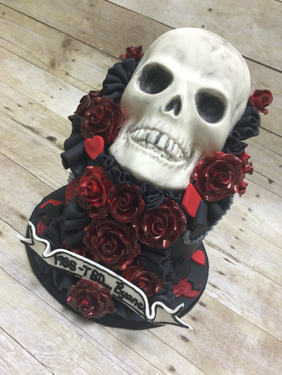 Skull cake with red and black flowers