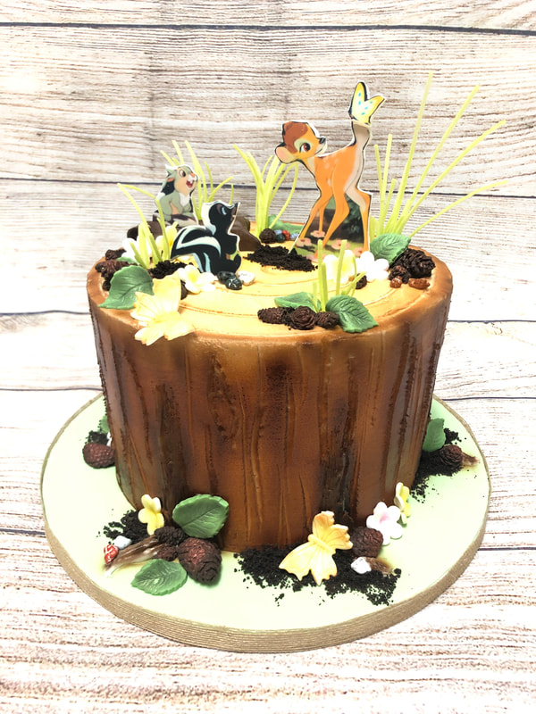 woodland theme baby shower cake.