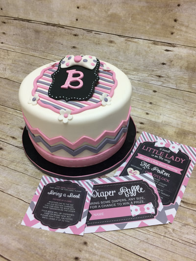 single tier fondant baby shower cake in white, pink, grey colors. all matching party invitations.